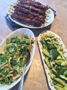 Beijing street food: lamb kebabs (Yangrou Chuanr) and tiger salad (laohu cai)